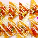 Tuna Salmon Nachos - Fresh Tuna and Salmon mixed with avocado, ginger, scallion, masago and ponzu sauce, delicious!