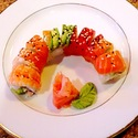 Rainbow Roll - Krab mix, avocado, cucumber, assorted fresh fish and shrimp on top with sesame seeds